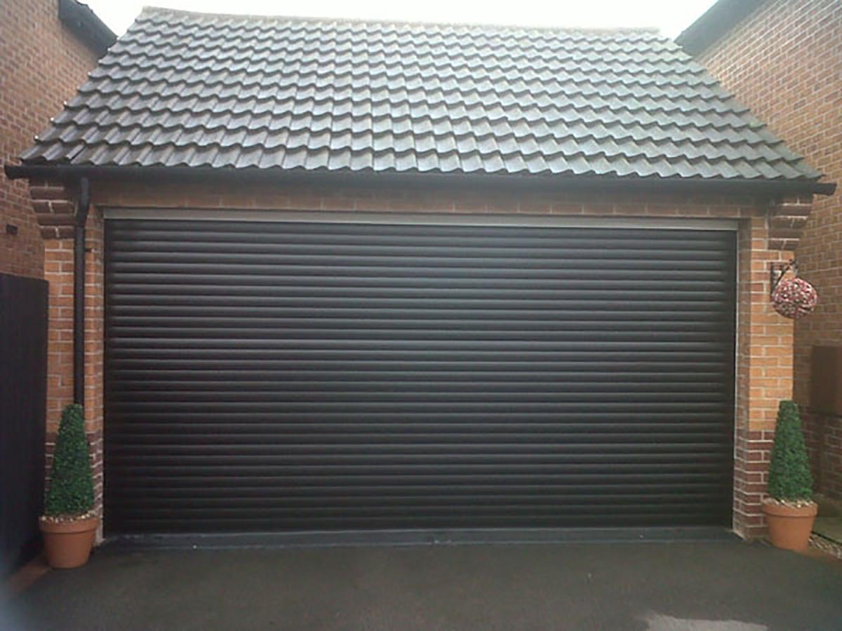 Large-black-green-roller-garage-doors